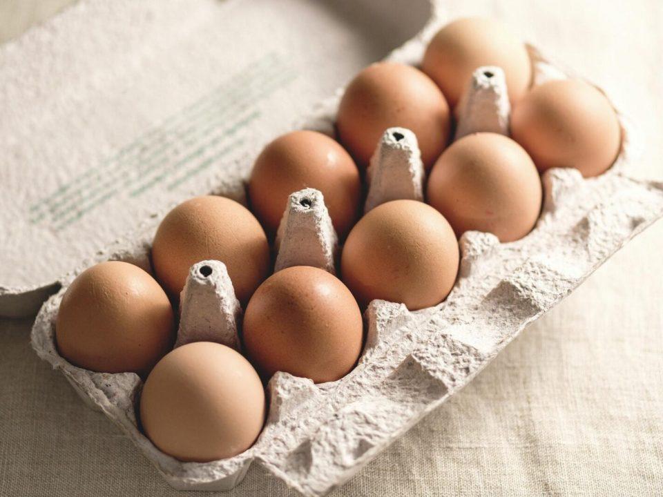 Top down on a cardboard carton of fresh eggs